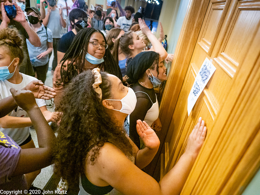 19 JUNE 2020 - DES MOINES, IOWA: Members and supporters of Black Lives Matter pound on the wall and door of the Governor's office during a Juneteenth rally in the Iowa State Capitol. About 100 supporters of Des Moines Black Lives Matter finished their week long series of protests at the Iowa State Capitol with a Juneteenth rally and demonstration. They are demanding that Gov. Kim Reynolds use an executive order to restore voting rights to felons who have completed their sentences. The protesters did not meet with the Governor Friday. The protest was peaceful.      PHOTO BY JACK KURTZ