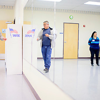 Ruben Sandoval steps up to the voting booth at the Future Foundations Family Center in Grants Tuesday at fill out his ballot for the school board election.