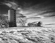 One is taken by a lonely feeling as the wind sweeps across the empty, abandoned farm that was once worked. A school now stands in place of these structures located on Kesslinger at Brundage Roads.