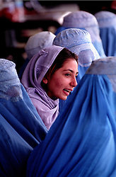 KABUL 25 August 2005.Women watching the Sport event at Ghazi Stadium..On 23-25 August 2005, Special Olympics Afghanistan held its first national Games at Olympic Stadium in Kabul. More than 300 athletes, including 80 female athletes, experienced a taste of happiness and achievement for the first time in their lives. They competed in athletics, bocce and football (soccer). Because of cultural restrictions, males and females competed at separate venues.