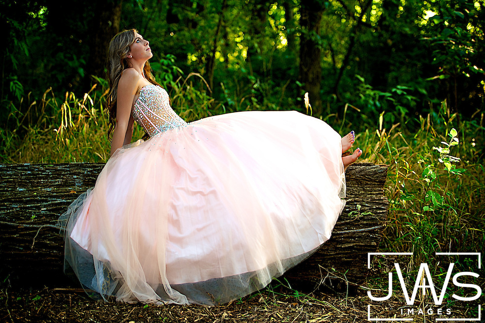 This senior picture was taken in Texas in a beautiful prom dress relaxing at sunset.