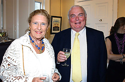 MR JAMES & DR SHIRLEY SHERWOOD, he is the founder and president of the Sea containers Group at a an exhibition of prints by art dealer Martin Summers held at 73 Glebe Place, London on 29th June 2004.