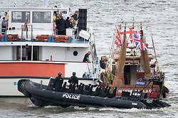 © Licensed to London News Pictures. 15/06/2016. London, UK.  Police watch as an 'In' boat is approached by a Vote Leave vessel (R) as campaigners converge on the Thames near Parliament. Photo credit: Peter Macdiarmid/LNP