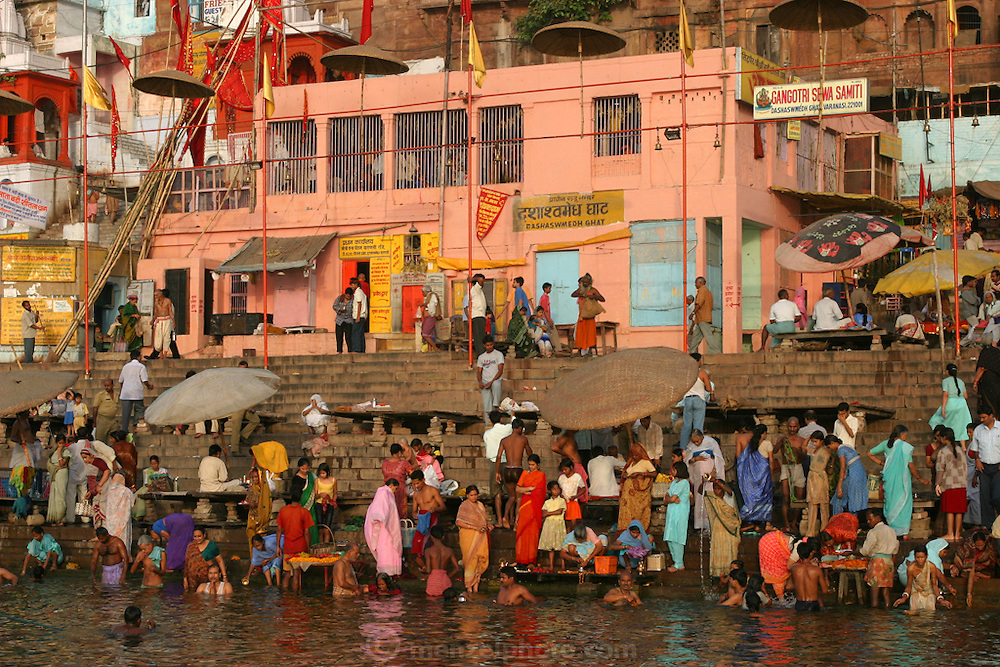 The colorful and popular Dasasvamedha Ghat  in the city of Varanasi, India, gets a lot of attention from religious pilgrims, locals, and tourists alike and is one of the busiest bathing ghats in Varanasi. A ghat is a stairway in India leading down to a landing on the water.