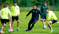 18/08/15<br /> CELTIC TRAINING<br /> LENNOXTOWN<br /> Celtic manager Ronny Deila (centre) gets involved in a training drill with his players.