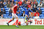 Cardiff's Kadeem Harris (c)  jumps the challenge of Nottingham's Eric Lichaj (on floor). EFL Skybet championship match, Cardiff city v Nottingham Forest at the Cardiff City Stadium in Cardiff, South Wales on Easter Monday 17th April 2017.<br /> pic by Carl Robertson, Andrew Orchard sports photography.