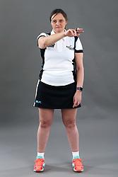 Umpire Rachael Radford signalling ball over third