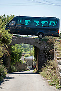 A vehicle carrying tourists crosses a bridge in Shkodër (Shkodra), Albania<br /><br />(September 2013)
