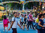 25 DECEMBER 2015 - SINGAPORE, SINGAPORE:  Pedestrians cross Orchard Road in Singapore while it is lit up with Christmas themed holiday lights. Orchard Road is the heart of Singapore's upscale shopping and consumerism.    PHOTO BY JACK KURTZ