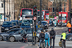 © Licensed to London News Pictures. 24/03/2020. London, UK. Cyclist and heavy traffic on Vauxhall Bridge Road this morning as Prime Minister Boris Johnson orders a police enforced lock-down on the UK as people are banned from leaving home except for food, medical reasons, exercise and essential work as the coronavirus crisis continues. Photo credit: Alex Lentati/LNP