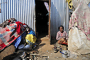 Dec. 29, 2015 - Kathmandu, NP, Nepal -<br /> <br /> Earthquake Survivors struggling in temporary Tent on Winter Season<br /> <br />  ASTA MAYA MAHARJAN, 75yrs, an earthquake survivor takes cooking things inside temporary tent after meal on 29 December, 2015 at Panga, Kirtipur, Kathmandu, Nepal. Most of houses in Panga, Kirtipur were destroyed by recent earthquake on April 25, 2015, a magnitude of 7.8 earthquake killing over 8,000 of people in Nepal and thousands of injured, which Outcomes Hundreds of people were homeless with entire villages across many districts of the country.<br /> ©Exclusivepix Media