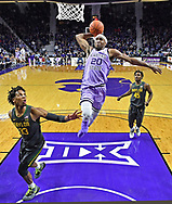 Xavier Sneed #20 of the Kansas State Wildcats dives in for a dunk over Freddie Gillespie #33 of the Baylor Bears during the first half at Bramlage Coliseum on February 3, 2020 in Manhattan, Kansas.