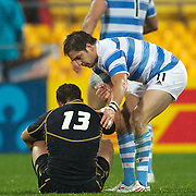 Argentina's Horacio Agulla comforts Scottish player Nic De Luca after Argentina's one point win during the Argentina V Scotland, Pool B match at the IRB Rugby World Cup tournament. Wellington Regional Stadium, Wellington, New Zealand, 25th September 2011. Photo Tim Clayton...
