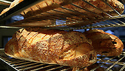 "Freshly baked loaves of bread at a bakery. This image was part of a photo exhibition ""Let there be Bread"" by Oren Shalev in the Eretz Israel Museum in Tel Aviv, Israel. The motif of the exhibition was bread. Such a basic food yet so complex and diverse. The images were produced by following the nightly work at a bakery from start to finish. To view all images from this exhibition please search for breadexhibition"