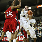 Central Florida guard A.J. Rompza (3) drives to the basket against Louisiana's center Courtney Wallace (20) and Louisiana's guard Raymone Andrews (22) during their game at the UCF Arena on December 15, 2010 in Orlando, Florida. UCF won the game79-58. (AP Photo/Alex Menendez)