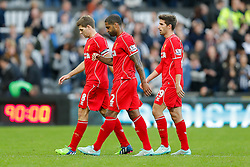 Glen Johnson, Steven Gerrard and Fabio Borini of Liverpool look dejected as they leave the pitch after a 1-0 loss - Photo mandatory by-line: Rogan Thomson/JMP - 07966 386802 -01/11/2014 - SPORT - FOOTBALL - Newcastle, England - St James' Park - Newcastle United v Liverpool - Barclays Premier League.