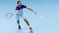 Tennis - 2017 Nitto ATP Finals at The O2 - Day Five<br /> <br /> Group Boris Becker Singles: Roger Federer (Switzerland) Vs Marin Cilic (Croatia)<br /> <br /> Marin Cilic (Croatia) stretches to reach a Roger Federer (Switzerland) serve ahead of his departure from the tournament at the O2 Arena<br /> <br /> COLORSPORT/DANIEL BEARHAM