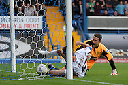 Bury's Danny Nardiello pounces on the ball to score his sides third goal against Burton's keeper Jon McLaughlin. Skybet football league two match, Bury v Burton Albion at the JD Stadium, Gigg Lane in Bury, Lancs on Saturday 20th Sept 2014.<br /> pic by David Richards,  Andrew Orchard sports photography.