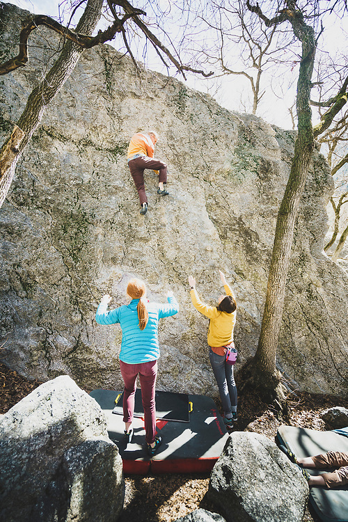 Jimmy Keithley climbs Green Slab, V0, with his family spotting, Little Cottonwood Canyon, Utah.