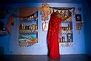 A hindu woman does the chores around their village house, Salawas, Rajasthan, India.