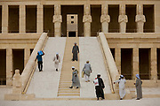 "Local guides and caretakers on the steps at the otherwise deserted ancient Egyptian Temple of Hatshepsut near the Valley of the Kings, Luxor, Nile Valley, Egypt. According to the country's Ministry of Tourism, European visitors to Egypt is down by up to 80% in 2016 from the suspension of flights after the downing of the Russian airliner in Oct 2015. Euro-tourism accounts for 27% of the total flow and in total, tourism accounts for 11.3% of Egypt's GDP. The Mortuary Temple of Queen Hatshepsut, the Djeser-Djeseru, is located beneath cliffs at Deir el Bahari (""the Northern Monastery""). The mortuary temple is dedicated to the sun god Amon-Ra and is considered one of the ""incomparable monuments of ancient Egypt."" The temple was the site of the massacre of 62 people, mostly tourists, by Islamists on 17 November 1997."