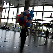 DONETSK, UKRAINE - April 17, 2014: A pro-Russia protestor is seen carrying a bunch of balloons, with Russian flag colours, during a small scale protest at Donetsk airport.