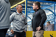 Huddersfield Giants Head Coach Simon Woolford and Wigan Warriors Head Coach Adrian Lam speak before the Betfred Super League match between Huddersfield Giants and Wigan Warriors at the John Smiths Stadium, Huddersfield, England on 1 March 2020.