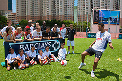 Hong Kong, China - Wednesday, July 25, 2007: Portsmouth's David James during a coaching session with local children at the Siu Sai Wan Sports Ground in Hong Kong. Liverpool, Fulham and Portsmouth players pose for a photograph with local children including Andriy Voronin, Jamie Carragher, Jermaine Pennant, Momo Sissoko, Sami Hyypia,Yossi Benayoun, Sol Campbell and Matthew Taylor (Photo by David Rawcliffe/Propaganda)