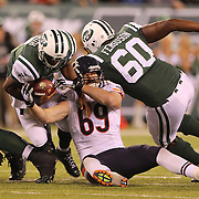 Geno Smith, New York Jets is tackled by Jared Allen, Chicago Bears, during the New York Jets Vs Chicago Bears, NFL regular season game at MetLife Stadium, East Rutherford, NJ, USA. 22nd September 2014. Photo Tim Clayton for the New York Times
