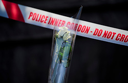 © Licensed to London News Pictures. 23/03/2017. London, UK. A single white rose placed on Westminster Bridge next to a police cordon, the day after a lone terrorist killed 4 people and injured several more, in an attack using a car and a knife. The attacker managed to gain entry to the grounds of the Houses of Parliament, killing one police officer. Photo credit: Ben Cawthra/LNP