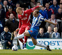 Photo: Jed Wee.<br />Hartlepool United v Bristol City. Coca Cola League 1. 15/04/2006.<br /><br />Bristol's Dave Cotterill (L) is tackled by Hartlepool's Ben Clark.