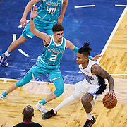 ORLANDO, FL - DECEMBER 17:  LaMelo Ball #2 of the Charlotte Hornets defends against Markelle Fultz #20 of the Orlando Magic at Amway Center on December 17, 2020 in Orlando, Florida. NOTE TO USER: User expressly acknowledges and agrees that, by downloading and or using this photograph, User is consenting to the terms and conditions of the Getty Images License Agreement. (Photo by Alex Menendez/Getty Images)