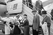 31/07/1962<br /> 07/31/1962<br /> 31 July 1962<br /> Arrival of Mr F. Kirk Johnston, Chairman, Ambassador Oil Corporation and President of Ambassador Irish Oil Company and James Stewart actor and Ambassador shareholder, at Dublin Airport. Mrs Johnston and Mrs Stewart receive flowers from Aer Lingus Hostess on arrival.