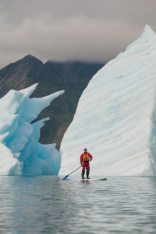 Standup paddleboarder in the lagoon at Bear Glacier in Alaska's Kenai Fjords. Photo © Robert Zaleski / rzcreative.com<br /> —<br /> To license this image contact: robert@rzcreative.com