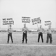 ackroyd-P095-01. (White supremacists picket the arrival of Vice-President Hubert Humphrey at Portland Airport, June 11, 1965. The Voting Rights Act of 1965, prohibiting racial discrimination in voting, was before Congress at this time.)