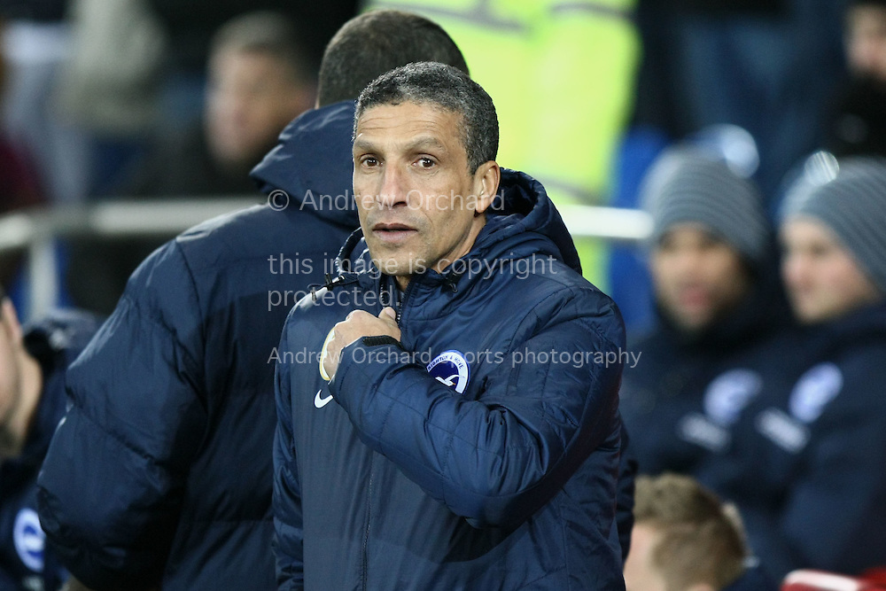 Brighton manager Chris Hughton looks on before kick off.<br /> Skybet football league championship match, Cardiff City v Brighton & Hove Albion at the Cardiff city Stadium in Cardiff, South Wales on Tuesday 10th Feb 2015.<br /> pic by Mark Hawkins, Andrew Orchard sports photography.