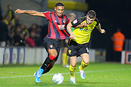 Bournemouth midfielder Jordon Ibe and Burton Albion forward Nathan Broadhead challenge for the ball during the EFL Cup match between Burton Albion and Bournemouth at the Pirelli Stadium, Burton upon Trent, England on 25 September 2019.
