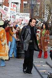 """Ewan McGregor portrays the late 1970s American fashion designer Roy Halston Frowick while filming """"Simply Halston"""" in Manhattan's Washington Square Park. Ewan was seen passing through a women's protest for the scene. 24 Feb 2020 Pictured: Ewan McGregor. Photo credit: LRNYC / MEGA TheMegaAgency.com +1 888 505 6342"""