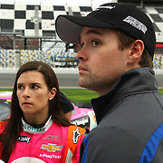 Danica Patrick, driver of the Florida Lottery Chevrolet, and Ricky Stenhouse Jr. watch the approaching storm after the qualifying practice session of the NASCAR Nationwide Drive4COPD 300 was cut short, at Daytona International Speedway on Friday, February 21, 2014 in Daytona Beach, Florida.  (AP Photo/Alex Menendez)