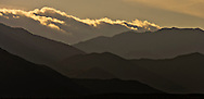the Santa Inez mountain ridges silhouetted in evening light in the Anza-Borrego Desert state Park, Borrego Springs, California, USA panorama