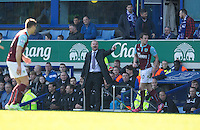 Burnley manager Sean Dyche shouts instructions to his team from the dug-out<br /> <br /> Photographer Stephen White/CameraSport<br /> <br /> Football - Barclays Premiership - Everton v Burnley - Saturday 18th April 2015 - Goodison Park - Everton<br /> <br /> © CameraSport - 43 Linden Ave. Countesthorpe. Leicester. England. LE8 5PG - Tel: +44 (0) 116 277 4147 - admin@camerasport.com - www.camerasport.com