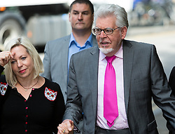 © Licensed to London News Pictures. 25/06/2014. London, UK. Artist and television personality, Rolf Harris arrives at Southwark Crown Court in London on 25th June 2014 with his daughter Bindi. Jury deliberations continue as they attempt to reach unanimous verdicts in Harris's child sex abuse trial.. Photo credit : Vickie Flores/LNP