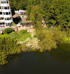 Bren Cottage, adjacent to an exclusive apartment block, the home of artist Jita Lukka, 57, is built without planning consent, from recycled materials on land overlooking the Vale of Health Pond in leafy Hampsead in West London, has to be pulled down after an appeal to Camden Council failed. London, September 20 2019.