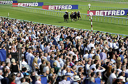 The runners in the Betfred Mobile Handicap Stakes race down the straight during Betfred Rose Of Lancaster Stakes Ladies Day at Haydock Park Racecourse.