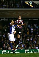 Photo: Steve Bond.<br />Birmingham City v Sunderland. The FA Barclays Premiership. 15/08/2007. Roy O'Donovon (R) wins an aerial duel