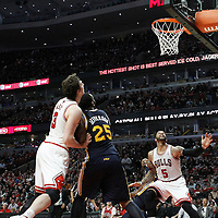10 March 2012: Chicago Bulls center Omer Asik (3), Utah Jazz center Al Jefferson (25) and Chicago Bulls power forward Carlos Boozer (5) eyes the ball during the Chicago Bulls 111-97 victory over the Utah Jazz at the United Center, Chicago, Illinois, USA.