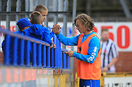 15 year old substitute Luke Matheson signs autographs during the EFL Sky Bet League 1 match between Rochdale and Gillingham at Spotland, Rochdale, England on 15 September 2018.