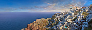 Panoramic view of Oia (ia), Cyclades Island of  Thira, Santorini, Greece.<br /> <br /> The settlement of Oia had been mentioned in various travel reports before the beginning of Venetian rule, when Marco Sanudo founded the Duchy of Naxos in 1207 and feudal rule was instituted on Santorini. n 1537, Hayreddin Barbarossa conquered the Aegean islands and placed them under Sultan Selim II. However, Santorini remained under the Crispo family until 1566, passing then to Joseph Nasi and after his death in 1579 to the Ottoman Empire. .<br /> <br /> If you prefer to buy from our ALAMY PHOTO LIBRARY  Collection visit : https://www.alamy.com/portfolio/paul-williams-funkystock/santorini-greece.html<br /> <br /> Visit our PHOTO COLLECTIONS OF GREECE for more photos to download or buy as wall art prints https://funkystock.photoshelter.com/gallery-collection/Pictures-Images-of-Greece-Photos-of-Greek-Historic-Landmark-Sites/C0000w6e8OkknEb8
