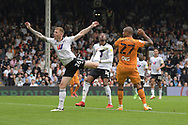 Fulham defender Alfie Mawson  (26)  and Hull City forward Josh Magennis  (27)  battles for possession during the EFL Sky Bet Championship match between Fulham and Hull City at Craven Cottage, London, England on 21 August 2021.