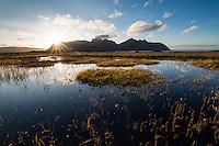 Rays of sunlight over bog, Grundstad, Vestvågøy, Lofoten Islands, Norway